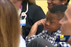 Baltimore boy, 9, talks about his double hand transplant