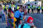 New Orleans police standby as their buddy pops the question