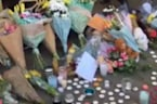 Bouquets and Candles Line Albert Square for Manchester Attack Victims