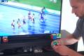 ボルトが100メートル走をゴールする間にルービックキューブを完成させる男