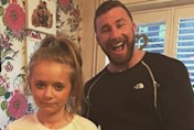 This will scare the boys off! Protective dad gives daughter a T-shirt showing his beefy body