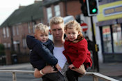 Heroic teen uncle dives in front of bus to save toddler twins