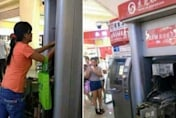 Woman destroys ATM with her bare hands