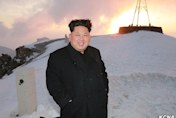 Kim Jong-un 'climbs North Korea's highest mountain' wearing overcoat
