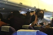 Mum attacks women on plane after they complain about crying baby