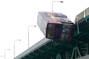 'London bus' falls off bridge and into river