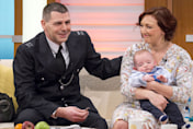 Hero policeman saved baby's life after running with him to hospital