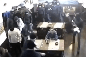 Masked gang storms restaurant - hungry man stays put