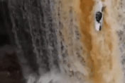 Kayaker plunges 50ft down waterfall (video)