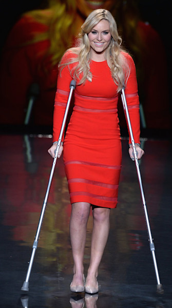 Lindsey Vonn walks the runway on crutches at the Red Dress Collection