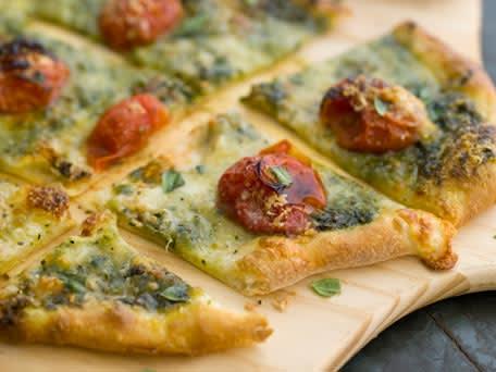 Homemade Pizza with Mozzarella, Cherry Tomatoes and Pesto