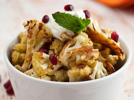 Cumin Seed Roasted Cauliflower with Salted Yogurt, Mint, and Pomegranate Seeds