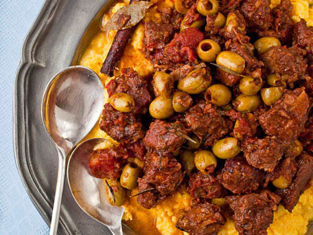 Braised Pork Shoulder with Tomatoes, Cinnamon, and Olives Over Polenta