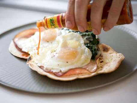 Crispy Tortilla with Ham, Chili, Spinach, and Fried Eggs