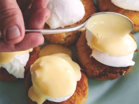 Poached Eggs & Satsuma Hollandaise over Crab Cakes