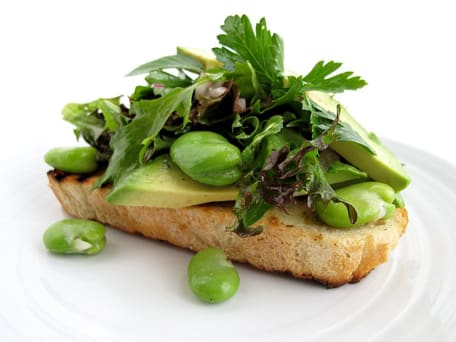 Fava Bean, Herb, and Avocado Salad on Bruschetta