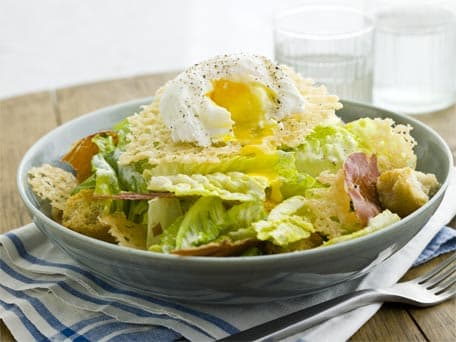 Caesar Salad with Poached Eggs, Crispy Prosciutto, and Parmesan Wafer