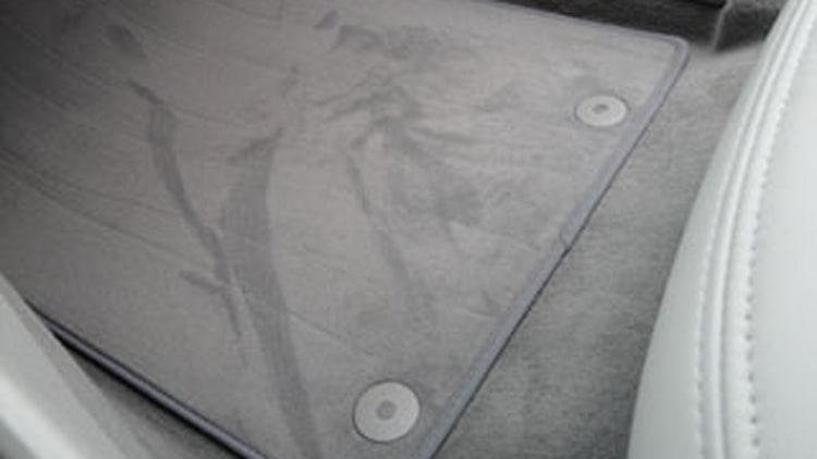 Clip or button-style floor mat anchors
