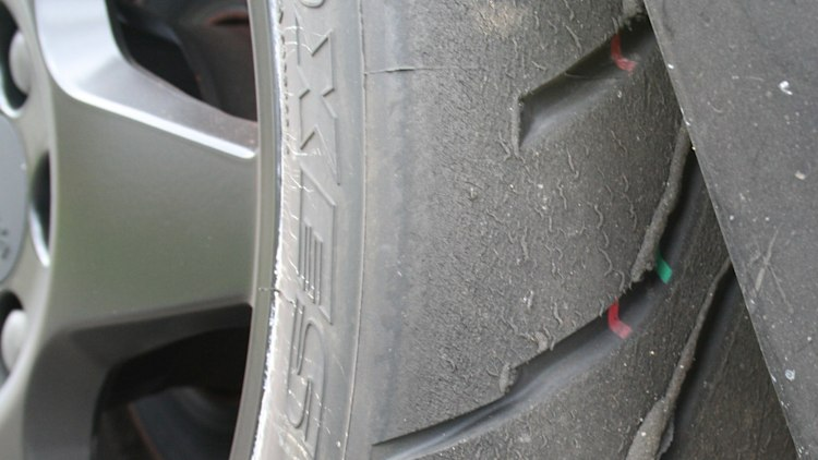 Look at tires for signs of uneven wear or other damage
