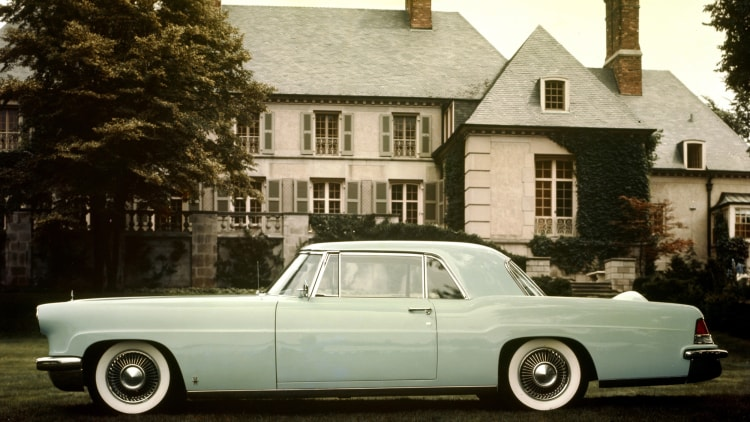 1956 Lincoln Continental Mk II green in front of house