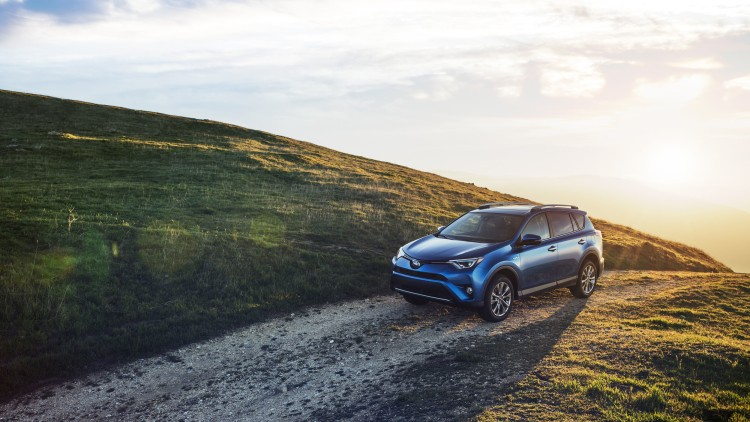 2016 Toyota RAV4 Hybrid in blue at sundown