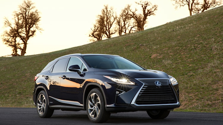 2016 Lexus RX450h in dark blue with lights on