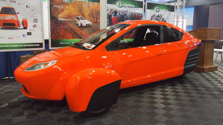 Elio Motors orange trike front three-quarter