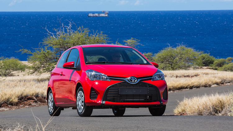 2014 Toyota Yaris in red at the ocean
