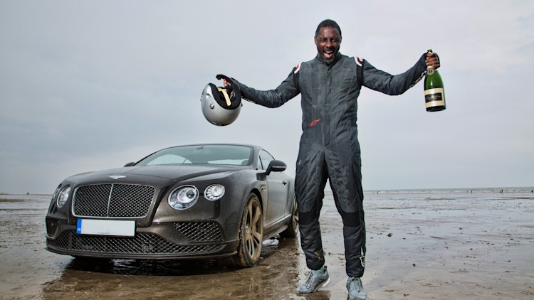 Idris Elba celebrates with the Bentley Continental GT Speed in Wales