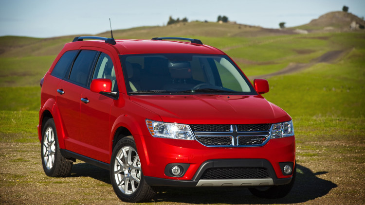 red 2015 dodge journey in a field