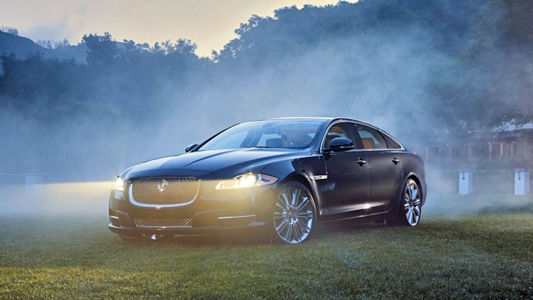 2010 Jaguar XJ in black in the fog