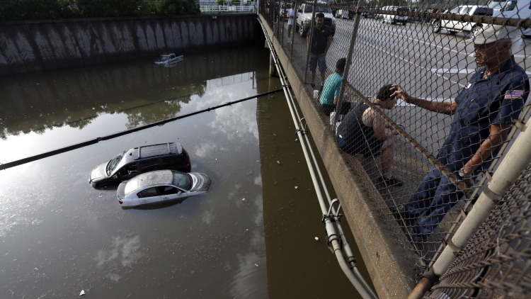 Cars sit in floodwaters along Interstate 45 in Houston