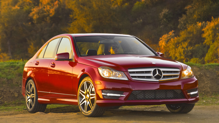 2014 Mercedes C-Class sedan in red