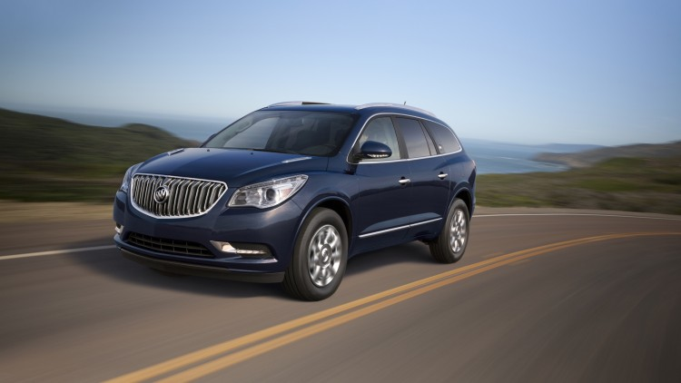 blue 2015 buick enclave front three quarters on curvy road