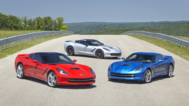 three 2015 chevy corvettes in red white and silver