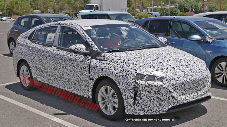 camouflaged hyundai prius-fighter spy shot front three quarters