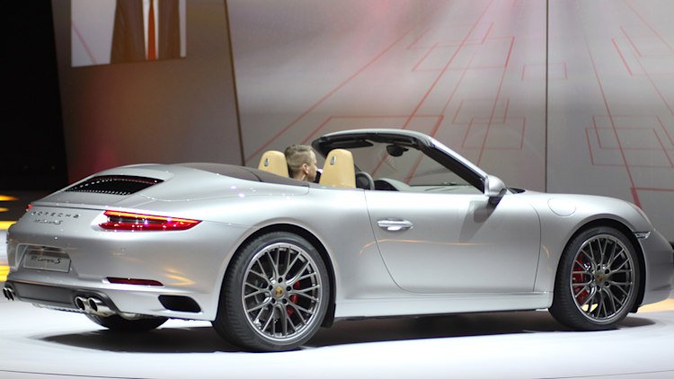 the 2016 porsche 911 carrera s cabriolet now with a turbocharged engine in the standard car unveiled at volkswagens group night ahead of the 2015