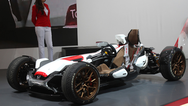 Honda Project 2 & 4 concept that combines the company's RC-213vs MotoGP bike with a car, at the 2015 Frankfurt Motor Show, low front three-quarter view.