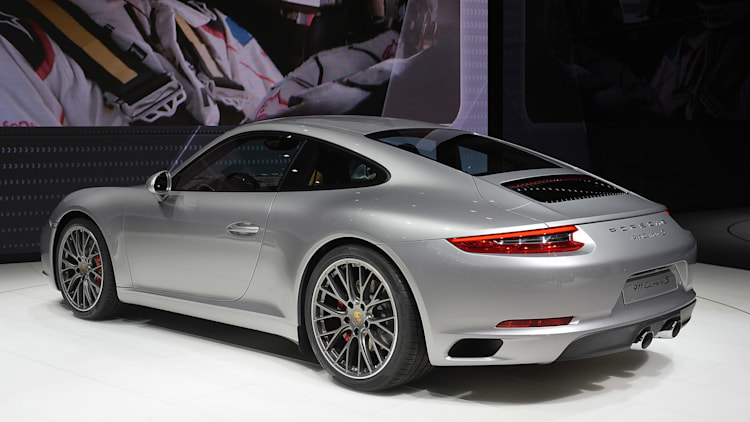 the 2016 porsche 911 carrera now with a turbocharged engine in the standard car unveiled at the frankfurt motor show rear three quarter view