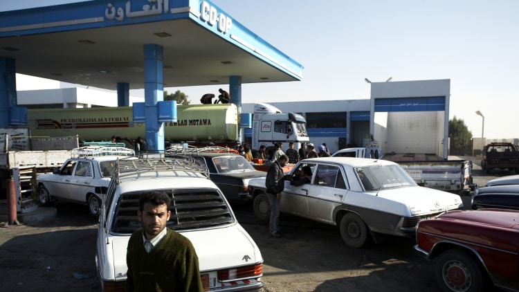 A Egyptian man waits by his car to refuel in a petrol station near the town of Rafah. Since Palestinians have been crossing freely into Egypt supplies such as fuel have been in high demand with long queues forming as well as prices increasing. Palestinians