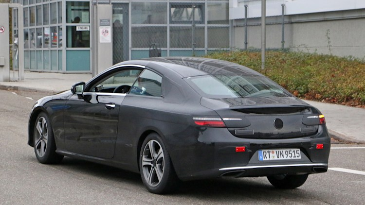 Nearly naked mercedes benz e class coupe spied in germany for Mercedes benz credit