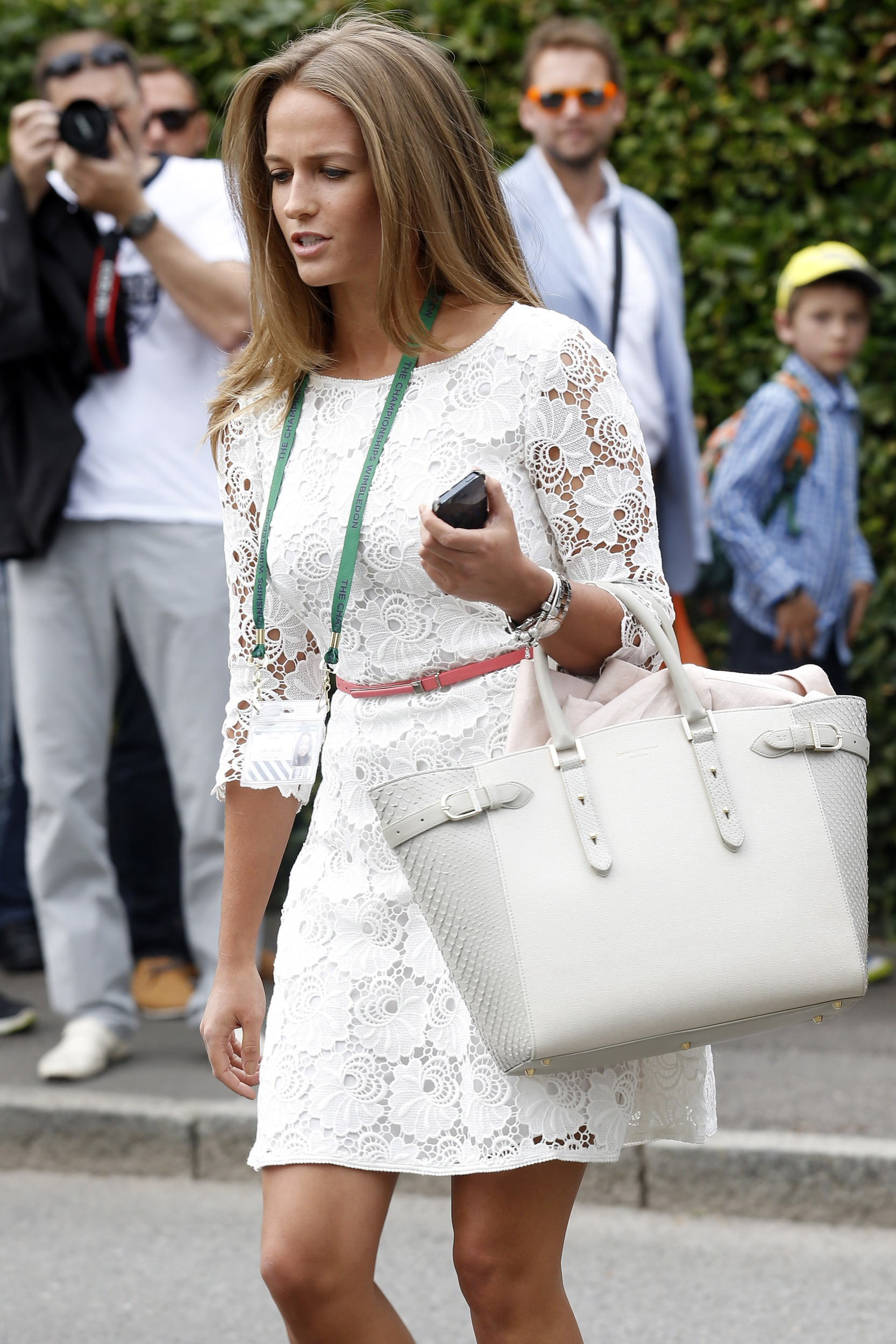 Kim Sears arrives for Day 1 of Wimbledon 2014 wearing a white lace Reiss dress.