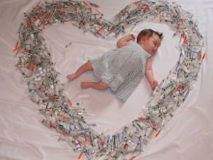 Mum Shares Powerful Photo Of Newborn Surrounded By The IVF Syringes That Helped Create Her
