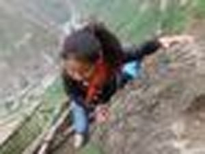 Watch These Chinese Kids Scale A 2,600-Foot Cliff To Get To School