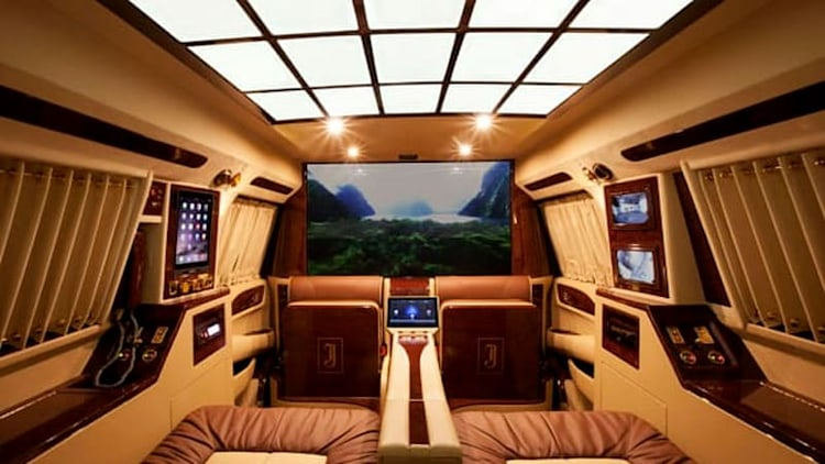 This dream home theater and office happens to be in a Cadillac Escalade [w/video]