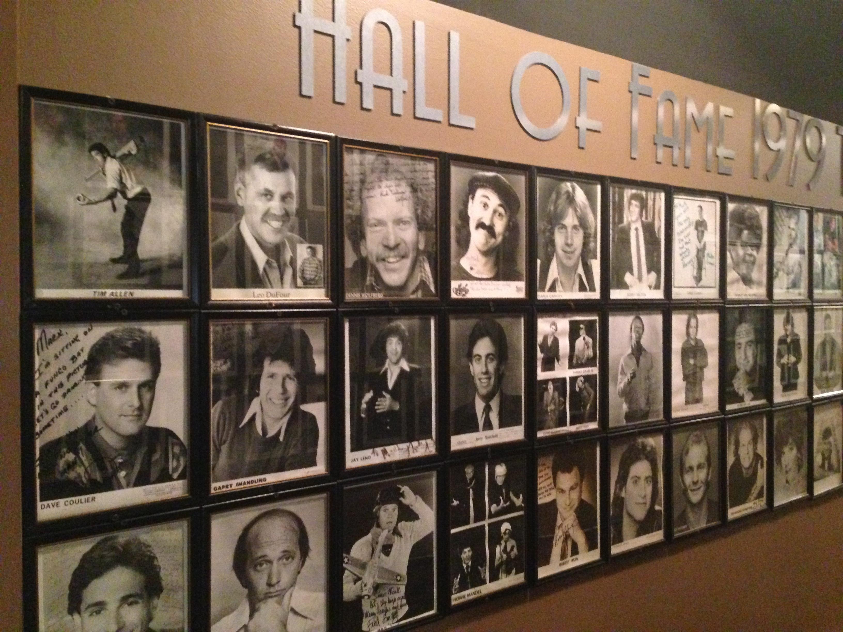 Over 100 photos of comedians on Wall of Fame