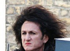 why is sean penn dressed like robert smith from the cure