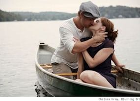 happy couple recreate the notebook in their engagement photos