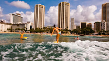 Surfing at Kuhio Beach