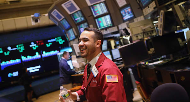 NEW YORK, NY - JULY 13:  A trader smiles on the floor of the New York Stock Exchange on July 13, 2012 in New York City. The Dow Jones Industrial Average rallied July 13, closing up almost 204 points to finish at 12,777. The rally ended a 6-day slump, the longest since mid-May.  (Photo by John Moore/Getty Images)